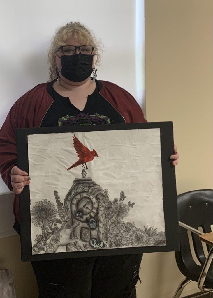 Bailee holding art